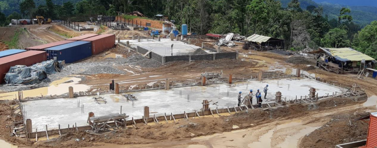 Views at June 27, 2020 of ongoing construction of foundations for the Administration building, warehouse, met lab and assay laboratory.