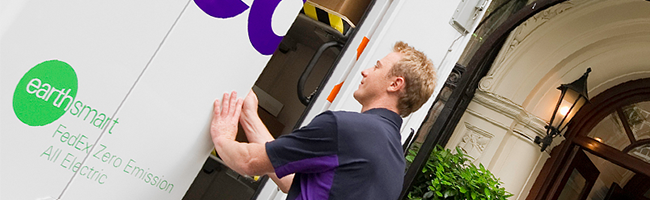 FedEx courier loading EarthSmart truck