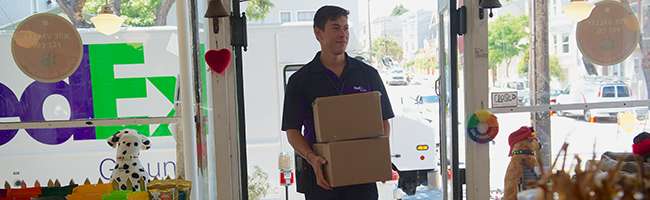 FedEx Ground driver delivering boxes to pet store