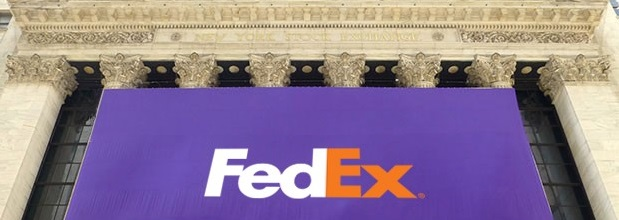 FedEx flag hanging on front of New York Stock Exchange building