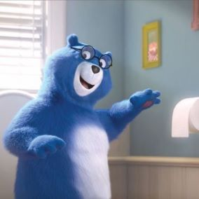 Blue Charmin bear reaching for toilet paper